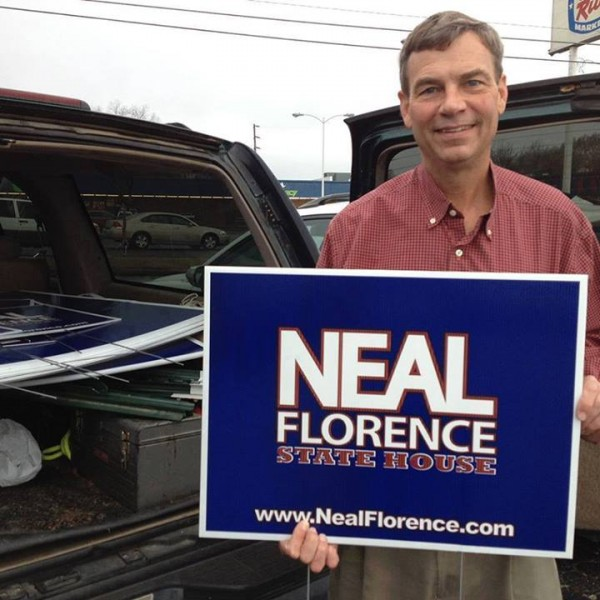 Neal Florence With Campaign Sign