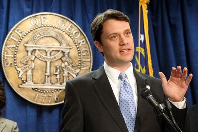 Jason Carter With State Seal
