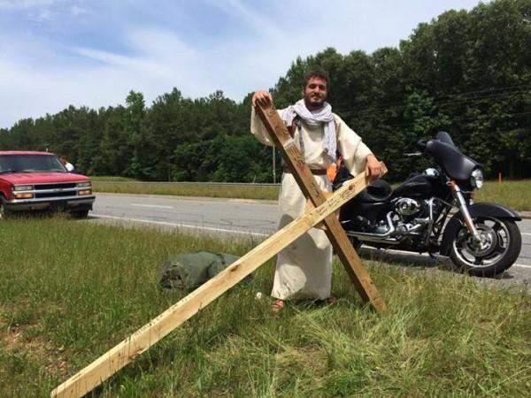 John Bessis Carrying Cross