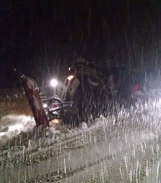 Snow Plow Flipped in Rock Spring
